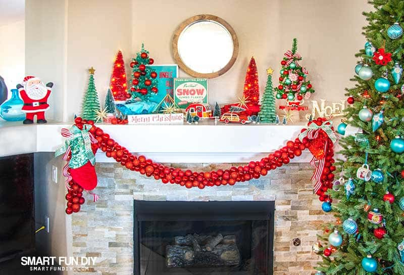 Fireplace mantle decorated for Christmas with chunky red ball ornament garland