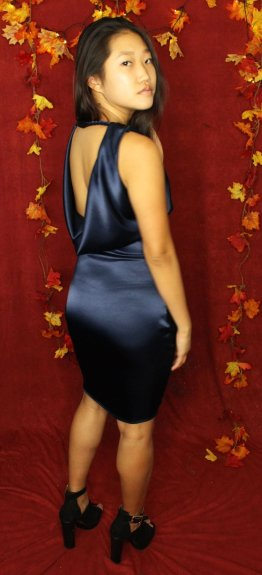 Satin dress with low and revealing cowl back