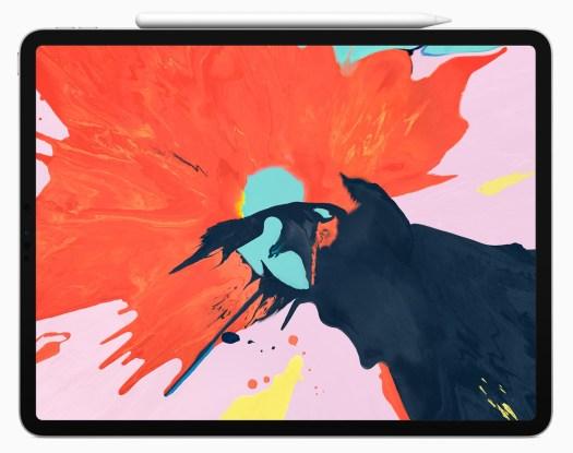 iPad Pro med hvit stylus festet til rammen.