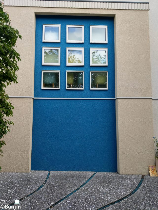 Blue wall and small windows
