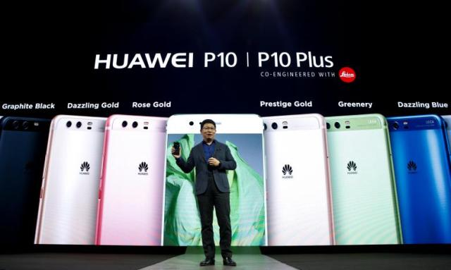 Richard Yu, chief executive of Huawei's consumer business, holds up a new P10 device during the presentation ceremony at Mobile World Congress in Barcelona, Spain, February 26, 2017. REUTERS/Paul Hanna