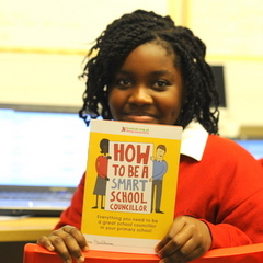 Girl holding 'How to be a SMART school councillor'