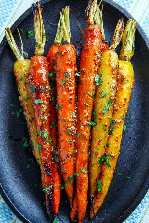 Sweet and tender roasted carrots in a tasty maple dijon glaze. easter recipes ideas dinner-easter recipes ideas-easter recipes side dishes-easter recipes dinner main courses-easter recipes appetizers #easter #easterrecipes #easyeaster #recipes