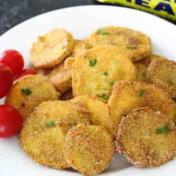 Tender rounds of yellow squash, lightly coated in seasoned cornmeal