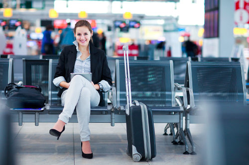 Happy business traveller
