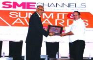 S C MITTAL OF BIZTEK ADVISORS GIVING AWAY SUPER50 AWARD TO COMNET VISION (I) PVT LTD