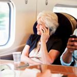 28159443 – businesswoman using mobile phone on busy commuter train