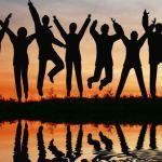 3019430 – silhouette jump team. sunset pond