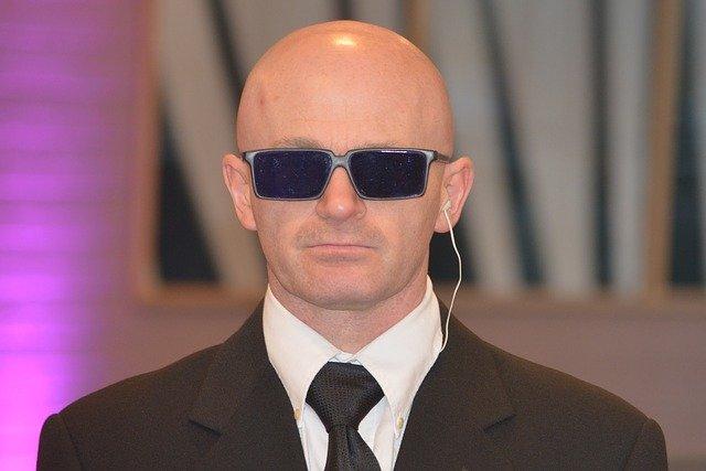 Bodyguard in dark glasses