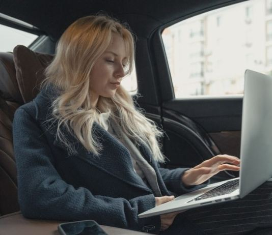 woman working in her car