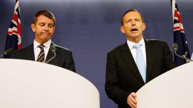 "Friendly fire: NSW Premier Mike Baird, left, congratulated Tony Abbott on recently increasing Australia's humanitarian intake for refugees, but said he should ""do more""."