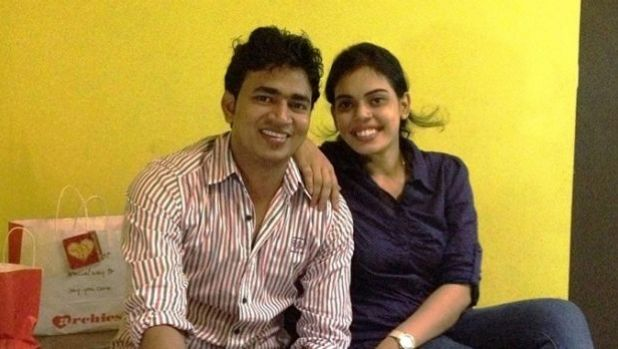 Pankaj Saw, pictured with his wife, died after falling from the balcony of an apartment in Macquarie Park.