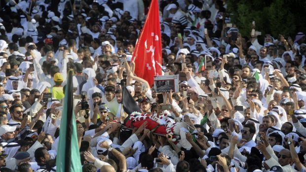 Thousands of Sunnis and Shiites from across the country take part in a mass funeral procession on Saturday for the 27 people killed in a suicide bombing.