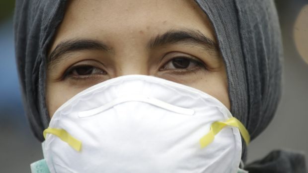 An Indonesian activist wears a mask during a protest demanding the government take quick action to suppress the haze from wildfires in Sumatra and Borneo.