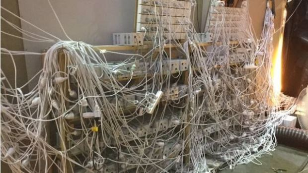 Police found a web of plug boards and extension leads.