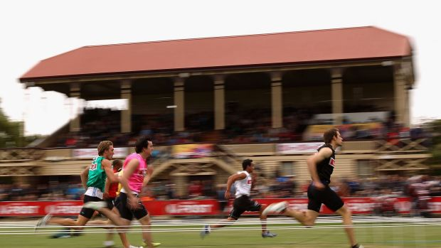 STAWELL, AUSTRALIA - APRIL 19:  Simon Fitzpatrick (R) of Windsor competes in Australia Post Stawell Gift 120 Metres Heat 18 during the 2014 Stawell Gift meet at Central Park on April 19, 2014 in Stawell, Australia.  (Photo by Robert Prezioso/Getty Images)