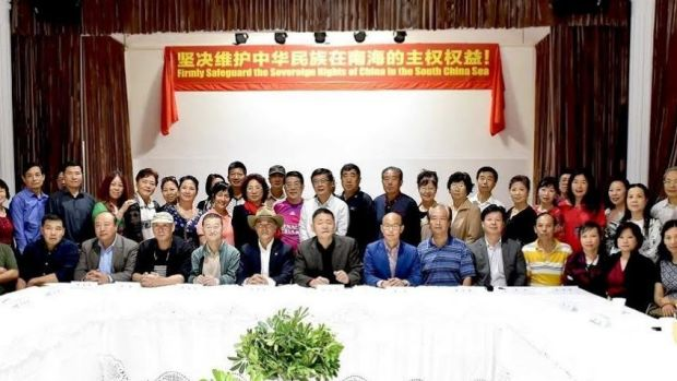 A meeting in Sydney of the Chinese patriotic association Australian Action Committee for Peace and Justice. The banner ...