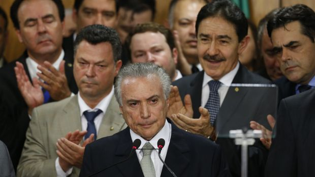 Brazil's interim President Michel Temer (centre) attends a signing ceremony for new government ministers on May 12.