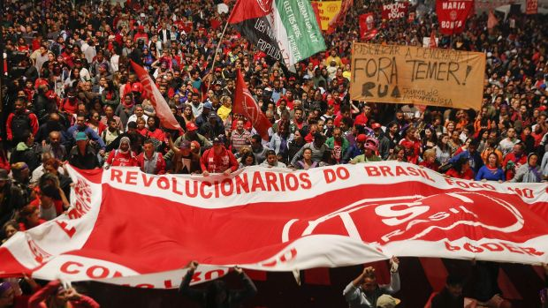 Thousands of demonstrators march during a protest organised by the Movement of the Roofless Workers, against Brazil's ...