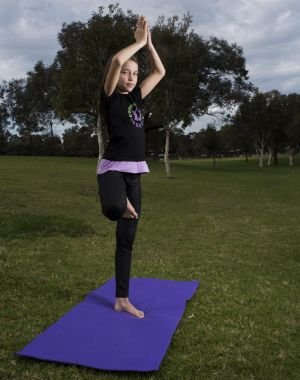 Molly Levin strikes a yoga pose at Henley Park in Enfield.