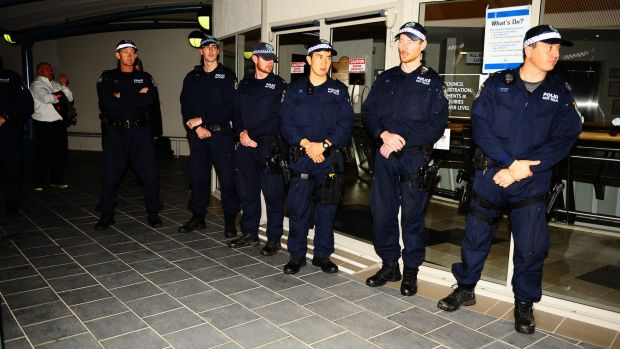 Police line up at Cessnock City Council, where protesters gathered as a mosque was approved on Wednesday night.