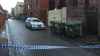 Police at the scene where a body was found in the early hours of Monday morning off Little Grey Street, St Kilda.