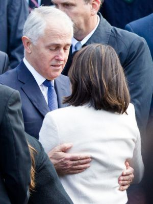 Prime Minister Malcolm Turnbull hugs Kathy Kelly at her son Stuart Kelly's funeral.
