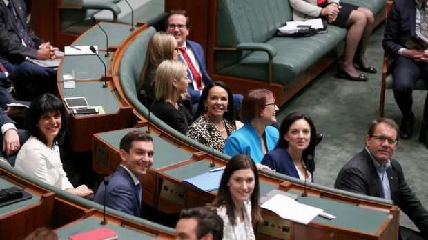 Say cheese: incoming MPs smile for the cameras on induction day.