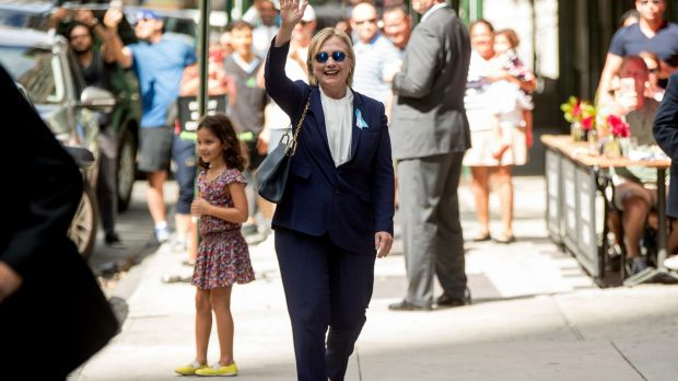 Democratic presidential candidate Hillary Clinton waves after leaving her daughter's apartment on Sunday.