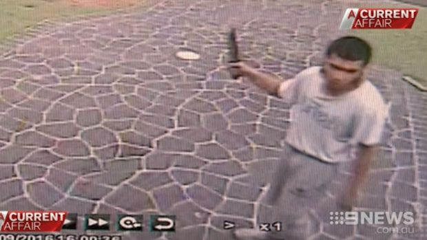 Footage shows Ihsas Khan outside the hair salon with knife in hand.