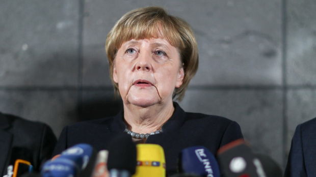 German Chancellor Angela Merkel, delivers a statement on Thursday to media.