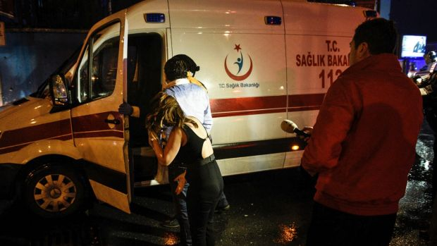 People talk to medics in an ambulance near the scene of an attack in Istanbul.