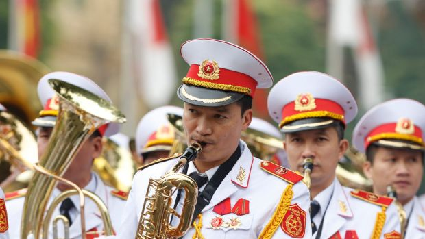 Military music band play before a welcoming ceremony for Japan's Prime Minister Shinzo Abe at the Presidential Palace in ...