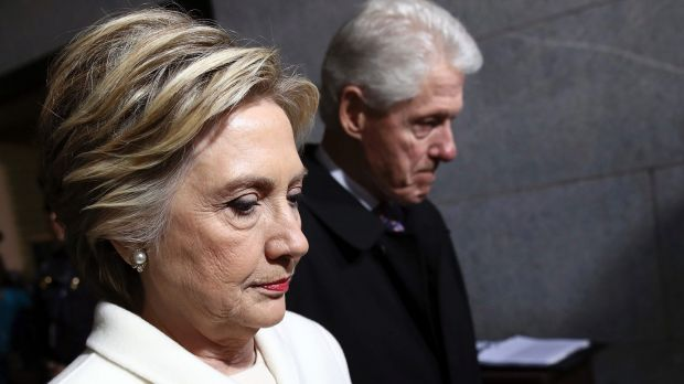 Facing up to failure: Hillary Clinton and her husband Bill arrive for the inauguration of US President Donald Trump in ...