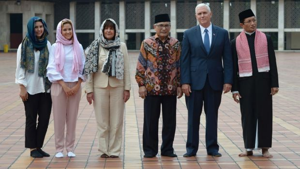 Mike Pence with, from left to right, his daughters Audrey and Charlotte, wife Karen, and dignitaries at the Istiqlal ...