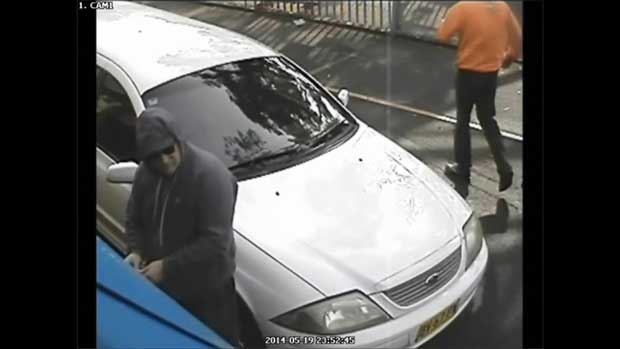 McNamara at front gate cctv still