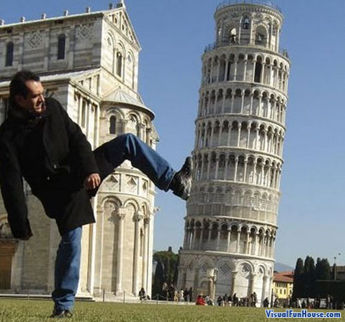 This man is Kicking over the leaning tower of pizza!