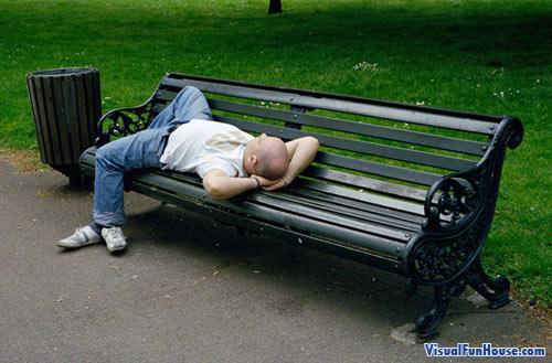 That man on the bench has three feet!