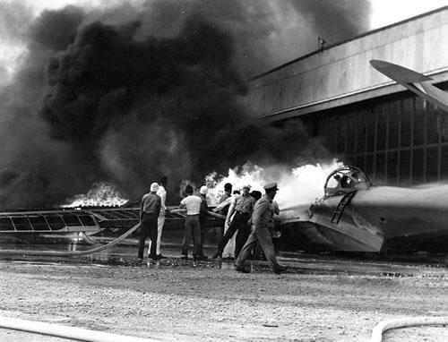 Burning PBY patrol bomber at Naval Air Station Kaneohe.