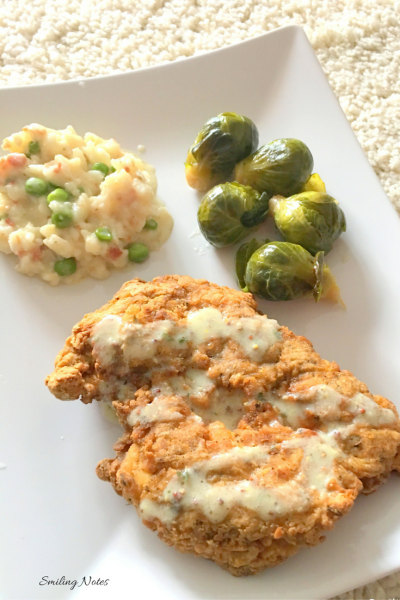 Fried chicken breast with risotto and brussel sprouts