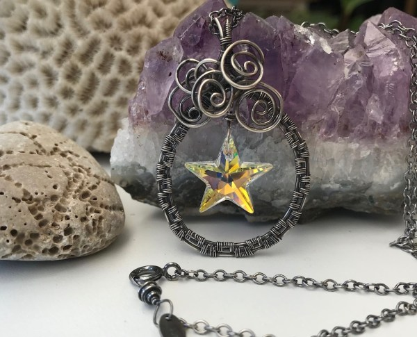 Håndflettet sølvhalskæde med stjerne