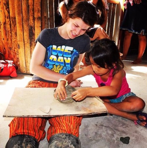 Caitlin playing with a young girl in the Amazon rainforest as a coordinator with We (formerly Me to We). (Credit: Caitlin's Instagram, Photographer: @mamma.lark)