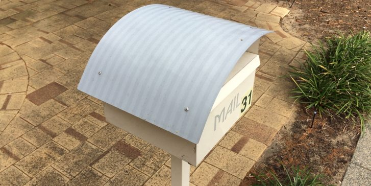 Tan coloured mailbox in West Perth