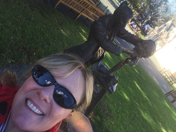 Shauna near a brass statue in Fremantle