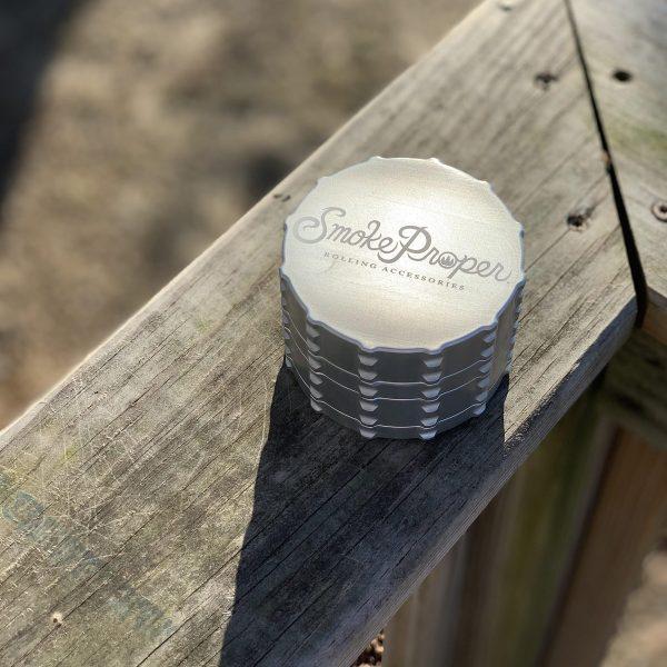 Smoke Proper grinder in Silver on railing