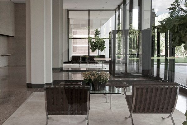 Looking into the lobby of an aparment building, the cross shaped columns are visible.