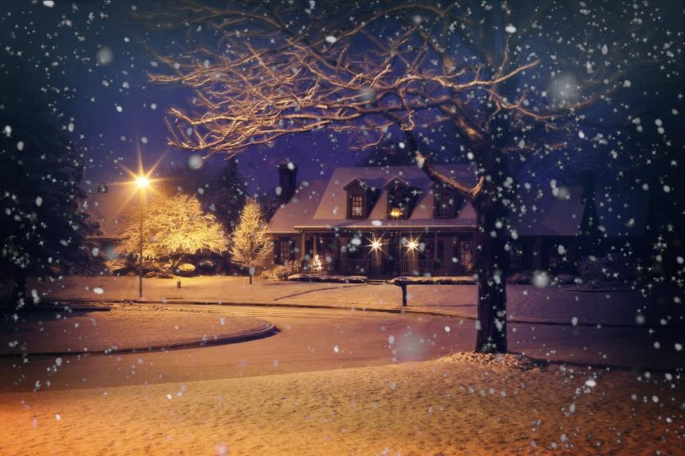 a house during the snowy evening