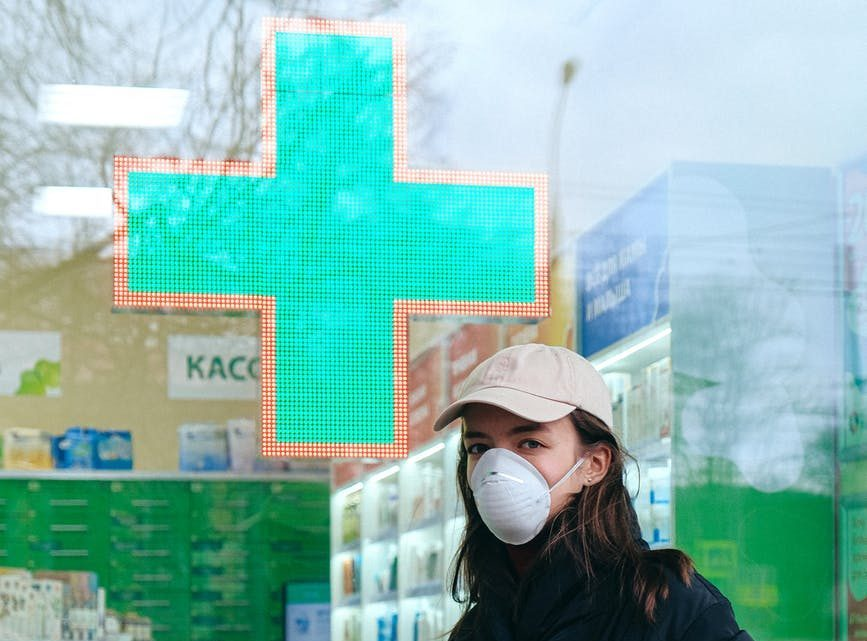 woman wearing face mask at pharmacy