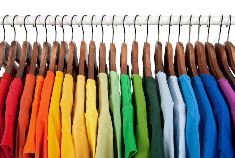 Rainbow colors, clothes on wooden hangers