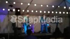 Apparel, Art, Audience, Audio Speaker, Blossom, Clothing, Coat, Crowd, Denim, Drummer, Face, Guitar, Guitarist, Human, LED, Leisure Activities, Lighting, Man, Music Band, Musical Instrument, Night, Tent